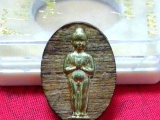 เหรียญไม้สักหน้ากากทองเหลืองไอ้ไข่เด็กวดเจดีย์
